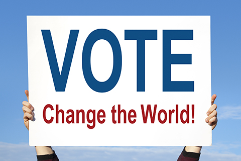 Picture of a sign that reads VOTE Change the World